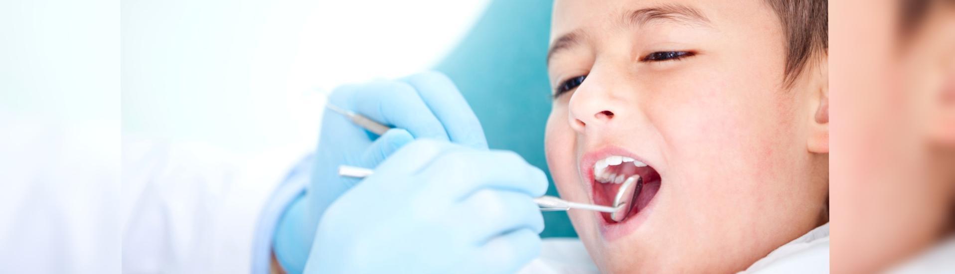 young boy having dental checkup