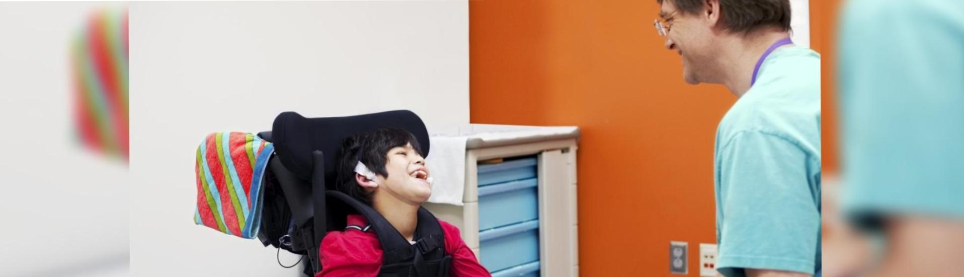 disabled boy having physical checkup