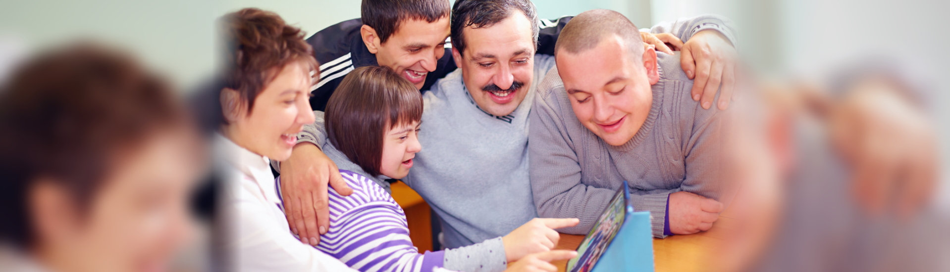 group people playing in an tablet
